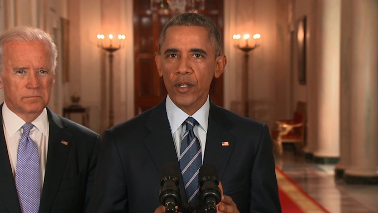 President Obama praises a nuclear deal with Iran as Vice President Biden looks on at the White House.