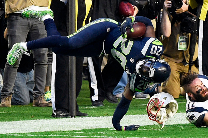 GLENDALE, AZ - FEBRUARY 01: Jeremy Lane #20 of the Seattle Seahawks is tackled after an interception by Julian Edelman #11 of the New England Patriots in the first quarter during Super Bowl XLIX at University of Phoenix Stadium on February 1, 2015 in Glendale, Arizona. (Photo by Harry How/Getty Images)