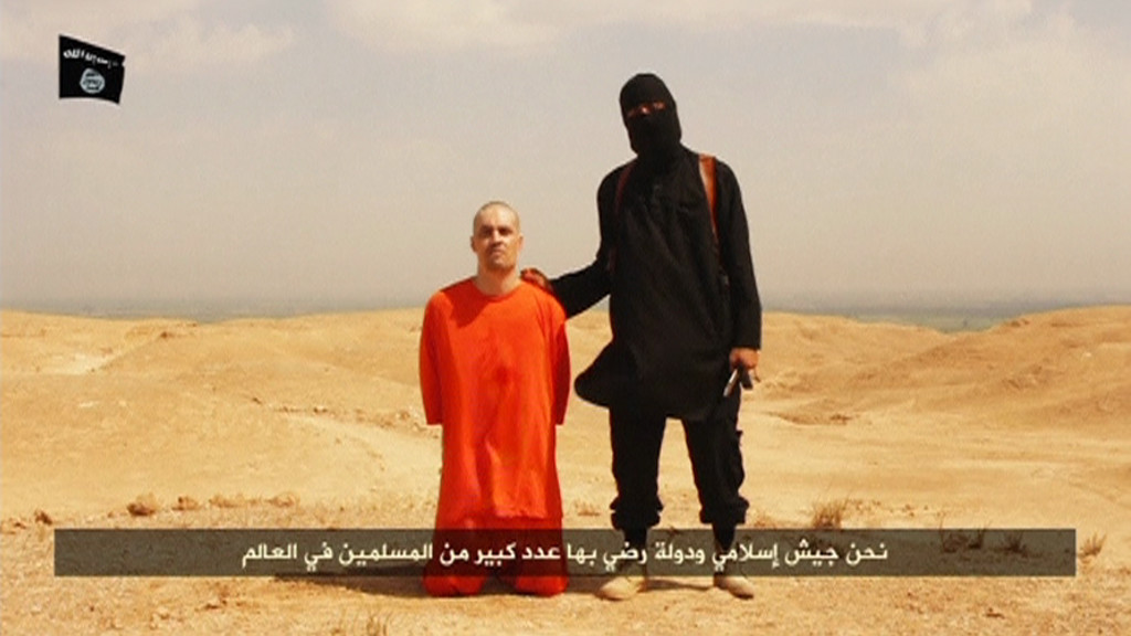 "REUTERS IS UNABLE TO INDEPENDENTLY VERIFY THE CONTENT OF THIS VIDEO, WHICH HAS BEEN OBTAINED FROM A SOCIAL MEDIA WEBSITE. A masked Islamic State militant holding a knife speaks next to man purported to be U.S. journalist James Foley at an unknown location in this still image from an undated video posted on a social media website. Islamic State insurgents released the video on August 19, 2014 purportedly showing the beheading of Foley, who had gone missing in Syria nearly two years ago, and images of another U.S. journalist whose life they said depended on U.S. action in Iraq. The video, titled ""A Message to America,"" was released a day after Islamic State, an al Qaeda offshoot that has overrun large parts of Iraq, threatened to attack Americans ""in any place."" U.S. officials said they were working to determine its authenticity. REUTERS/Social Media Website via REUTERS TV (Tags: CIVIL UNREST MEDIA TPX IMAGES OF THE DAY) ATTENTION EDITORS - THIS PICTURE WAS PROVIDED BY A THIRD PARTY. REUTERS IS UNABLE TO INDEPENDENTLY VERIFY THE AUTHENTICITY, CONTENT, LOCATION OR DATE OF THIS IMAGE. THIS PICTURE IS DISTRIBUTED EXACTLY AS RECEIVED BY REUTERS, AS A SERVICE TO CLIENTS. FOR EDITORIAL -- -- USE ONLY. NOT FOR SALE FOR MARKETING OR ADVERTISING CAMPAIGNS. NO SALES. NO ARCHIVES"