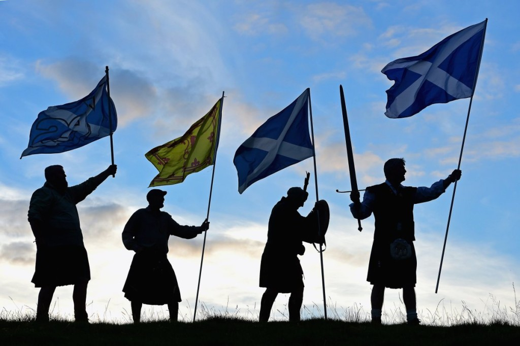 LOCH LOMOND, SCOTLAND - SEPTEMBER 14:  Duncan Thomson, Brian McCutcheon, John Patterson and Arthur Murdoch,from King of Scots Robert the Bruce Society, hold the Scottish flags as they prepare to vote in the Scottish independence referendum on September 14, 2014 in Loch Lomond. The latest polls in Scotland's independence referendum put the No campaign back in the lead, the first time they have gained ground on the Yes campaign since the start of August.  (Photo by Jeff J Mitchell/Getty Images)